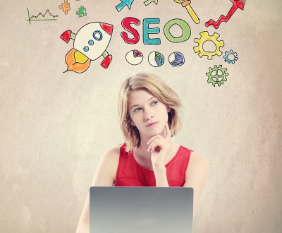 SEO concept with woman working on a laptop