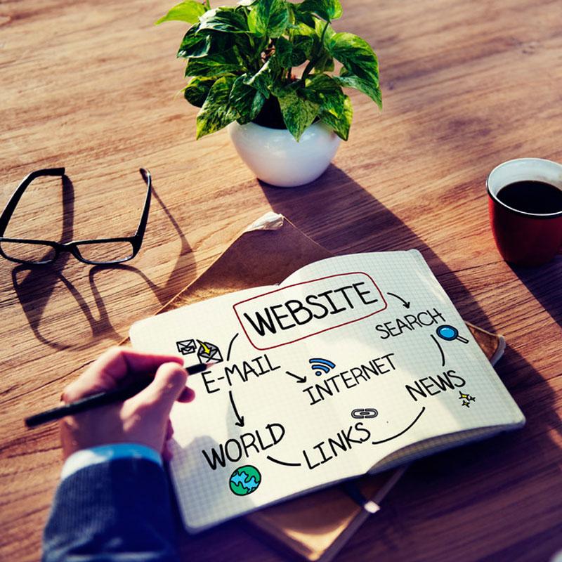 man writing website